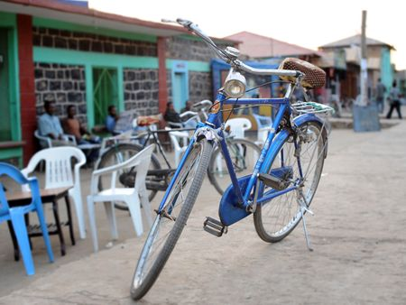 Blue Phoenix Bicycle near a cafe